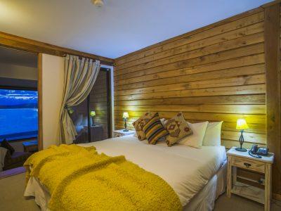 Bedroom in a suite at Weskar Patagonia Lodge, Puerto Natales, Chilean Patagonia, Chile